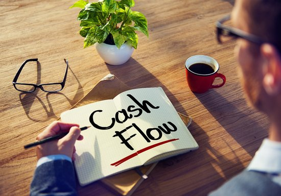 Man with a Note and Cash Flow Concept